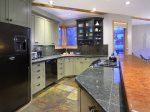 Open Kitchen with Bar Seating with Room For All The Chefs